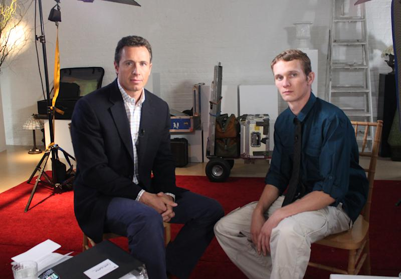 "This undated image released by ABC shows ABC News' Chris Cuomo, left, with Aaron Fisher, 18, a victim of former Penn State assistant football coach Jerry Sandusky during an interview airing Friday, Oct. 19, 2012 on the news magazine show ""20/20,"" at 10 p.m. EST on ABC. Sandusky wants his child sexual abuse charges tossed out ""and/or"" a new trial, saying the statute of limitations had run out for many of the 45 counts for which he was convicted in June. Currently in a county jail near State College, he is awaiting transfer to the state prison system to begin serving a 30- to 60-year sentence. Fisher said he was 11 when he met Sandusky and was abused during weekend visits at the Sandusky home. (AP Photo/ABC News)"