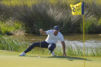 Brooks Koepka reads his birdie putt on the 13th hole during the second round of the PGA Championship golf tournament on the Ocean Course Friday, May 21, 2021, in Kiawah Island, S.C. (AP Photo/David J. Phillip)