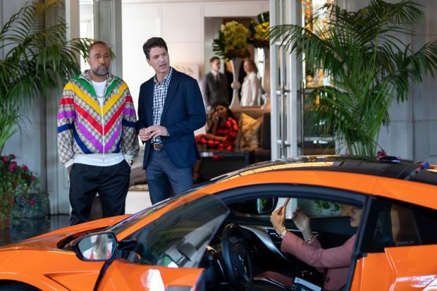A version of Kenya Barris stunts in his own Gucci track jacket, while a version of Steven Levitan judges the showrunner's luxury sports car in '#blackAF.'