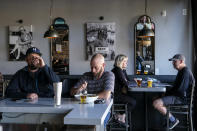Patrons dine at Notorious Burgers restaurant in Carlsbad, Calif., on Friday, Dec. 18, 2020. (AP Photo/Ringo H.W. Chiu)