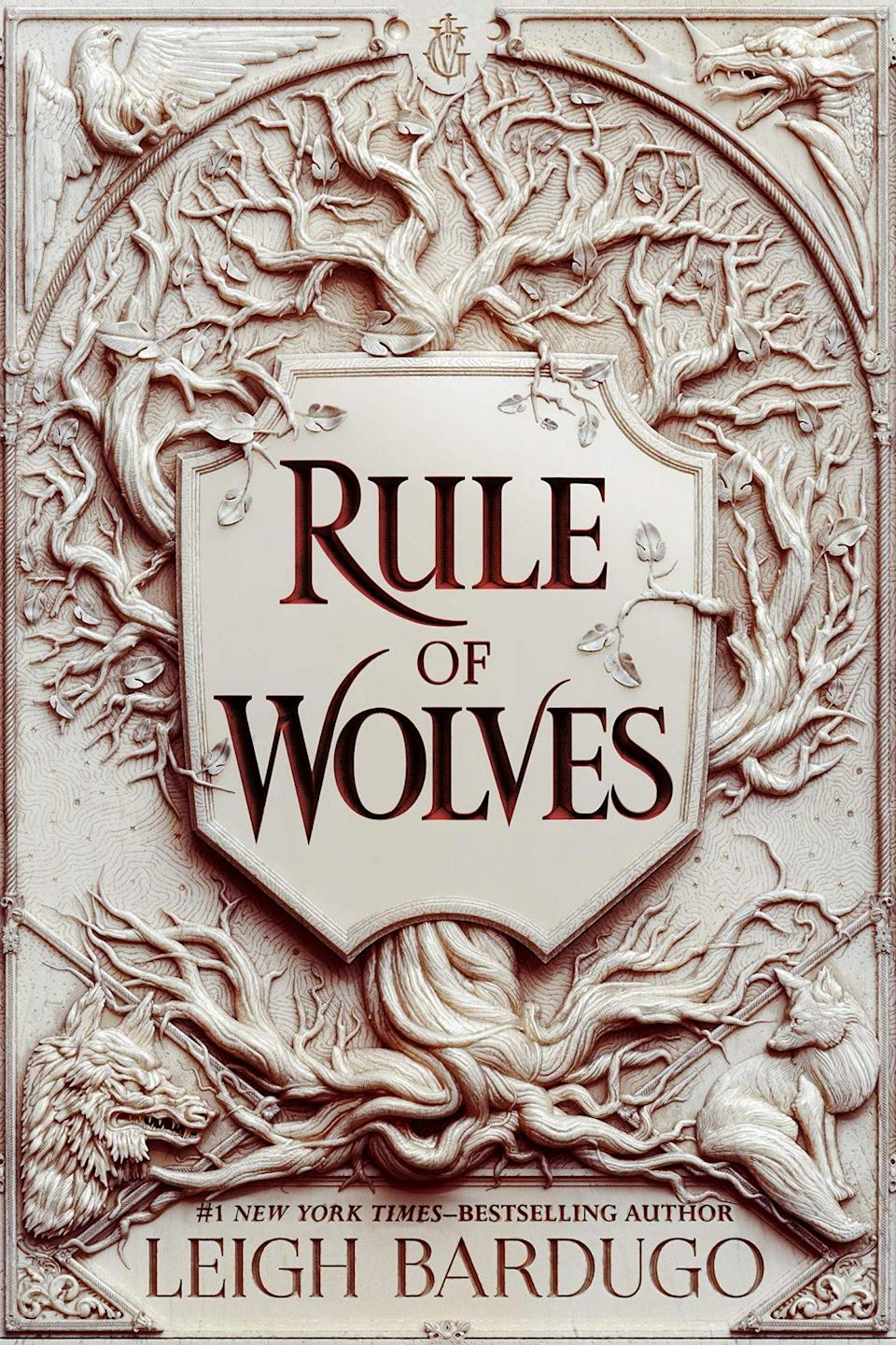 The cover for Rule of Wolves shows a family crest with the words Rule of Wolves within it
