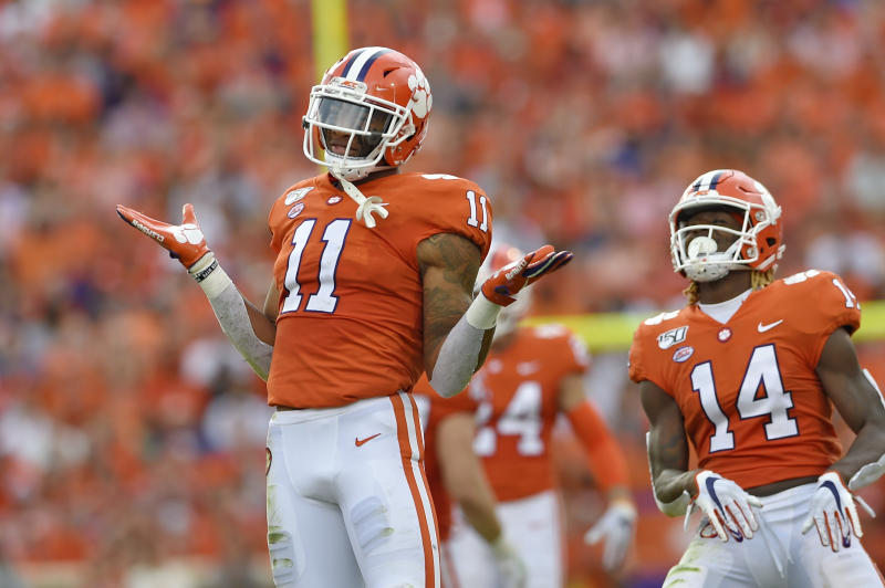FILE - In this Oct. 12, 2019, file photo, Clemson's Isaiah Simmons (11) and Denzel Johnson react after making a defensive play during the first half of an NCAA college football game against Florida State, in Clemson, S.C. Simmons was selected to The Associated Press All-Atlantic Coast Conference football team, and named Defensive Player of the Year, Tuesday, Dec. 10, 2019. (AP Photo/Richard Shiro, File)