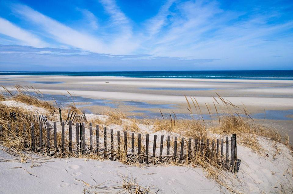 """<p>Cape Cod National Seashore stretches 40 miles along in the Cape Cod region of Massachusetts. With high dunes, great waves, beach volleyball courts, and a beachside boardwalk, <a href=""""http://capecodonline.com/cape-cod-beaches/eastham/coast-guard-beach/#:~:text=Coast%20Guard%20Beach%20is%20a%20great%20beach%20for%20boogie%20boarding!&text=Often%20recognized%20as%20one%20of,free%20shuttle%20to%20the%20beach."""" rel=""""nofollow noopener"""" target=""""_blank"""" data-ylk=""""slk:Coast Guard Beach"""" class=""""link rapid-noclick-resp"""">Coast Guard Beach</a> is a popular destination, while <a href=""""https://www.tripadvisor.com/Attraction_Review-g60754-d272310-Reviews-Marconi_Beach-Wellfleet_Cape_Cod_Massachusetts.html"""" rel=""""nofollow noopener"""" target=""""_blank"""" data-ylk=""""slk:Marconi Beach"""" class=""""link rapid-noclick-resp"""">Marconi Beach</a> offers big waves, white sand, amenities like restrooms, and easy beach access points. There are <a href=""""https://www.platinumpebble.com/shopping-on-cape-cod/shopping-on-cape-cod/"""" rel=""""nofollow noopener"""" target=""""_blank"""" data-ylk=""""slk:five Cape Cod Main Streets"""" class=""""link rapid-noclick-resp"""">five Cape Cod Main Streets</a> for visitors—Falmouth, Hyannis, Harwich Port, Chatham, and Provincetown—which offer window shopping, ice cream restaurants, and other family-friendly entertainment. Be sure to check if a Cape Cod beach you're visiting requires a a fee-based beach sticker upon entrance.<br></p>"""