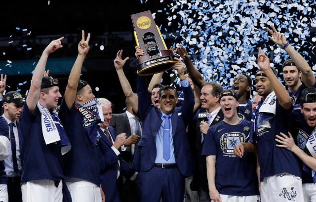 Villanova head coach Jay Wright, center, celebrates with his team after beating Michigan 79-62 in the championship game of the Final Four NCAA college basketball tournament, Monday, April 2, 2018, in San Antonio. (AP Photo/David J. Phillip)