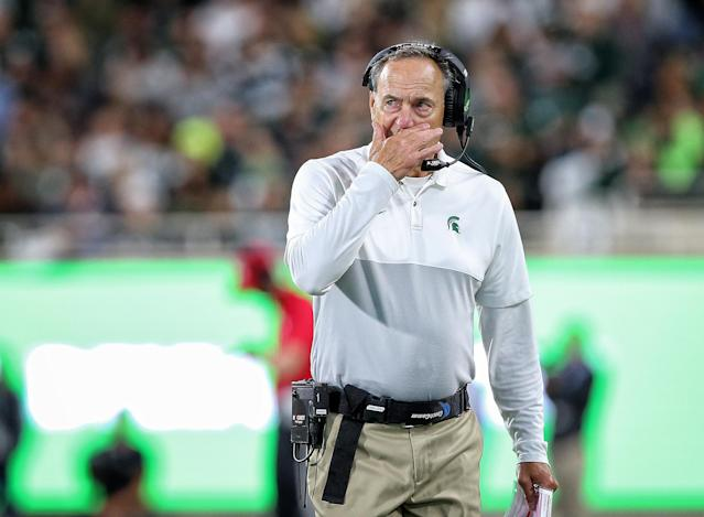 "<a class=""link rapid-noclick-resp"" href=""/ncaaf/teams/michigan-st/"" data-ylk=""slk:Michigan State Spartans"">Michigan State Spartans</a> head coach Mark Dantonio stands on the field during the second half of a game against Western Michigan. (Reuters)"