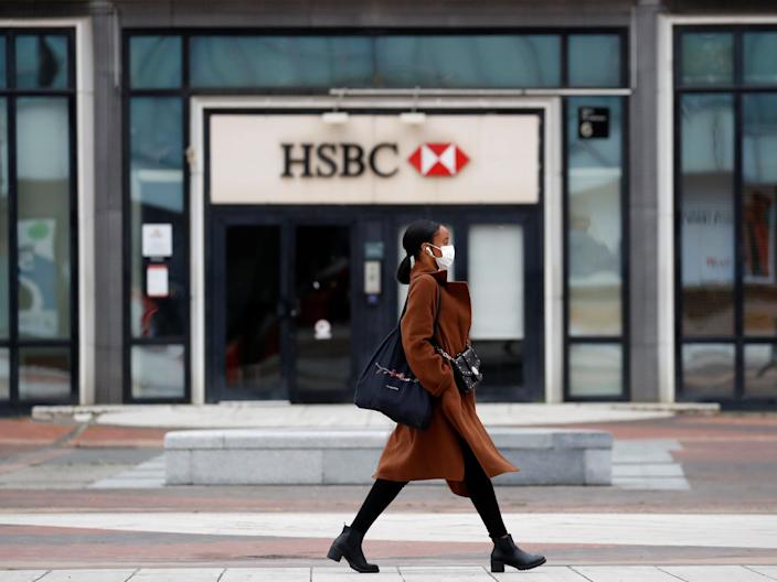 "A woman walks past an HSBC bank amid the coronavirus pandemic in Paris, France on May 11, 2020. <p class=""copyright"">Reuters</p>"