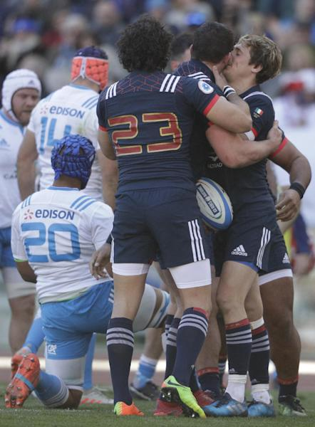 France's Louis Picamoles is celebrated by two teammates after scoring a try during a Six Nations rugby union international match between Italy and France at the Rome Olympic stadium, Saturday, March 11, 2017. (AP Photo/Gregorio Borgia))