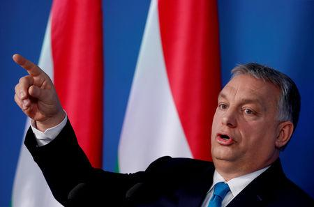 FILE PHOTO: Hungarian Prime Minister Viktor Orban gestures as he speaks during the weekly government news conference in Budapest, Hungary, January 10, 2019. REUTERS/Bernadett Szabo/File Photo