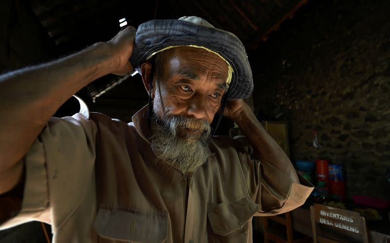 Sadiman, a 69-year-old ecowarrior, prepares to visit the forest at his house in Wonogiri, Central Java province, Indonesia