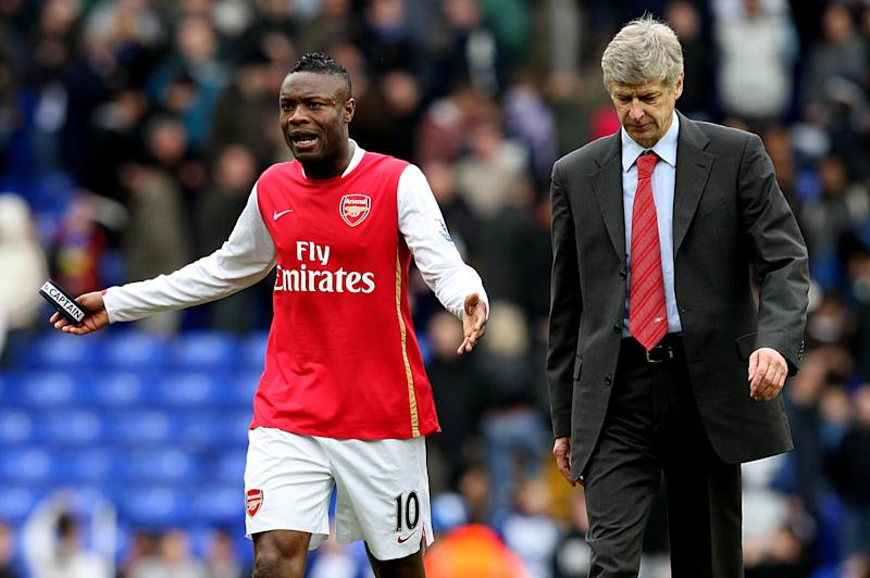 Arsenal maanager Arsene Wenger and William Gallas walk off dejected (Photo by Stephen Pond - PA Images via Getty Images)