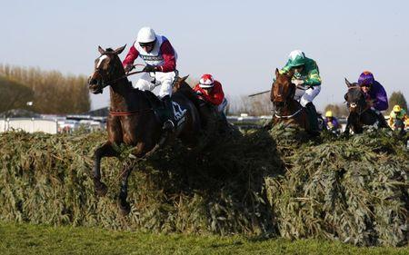 Britain Horse Racing - Grand National Festival - Aintree Racecourse - 8/4/17 Derek Fox on One For Arthur in action during the 5:15 Randox Health Grand National Reuters / Phil Noble Livepic
