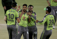 Lahore Qalandars' Haris Rauf, second left, celebrates with teammates after after taking the wicket of Quetta Gladiators' Tom Banton during a Pakistan Super League T20 cricket match between Lahore Qalandars and Quetta Gladiators at the National Stadium, in Karachi, Pakistan, Monday, Feb. 22, 2021. (AP Photo/Fareed Khan)