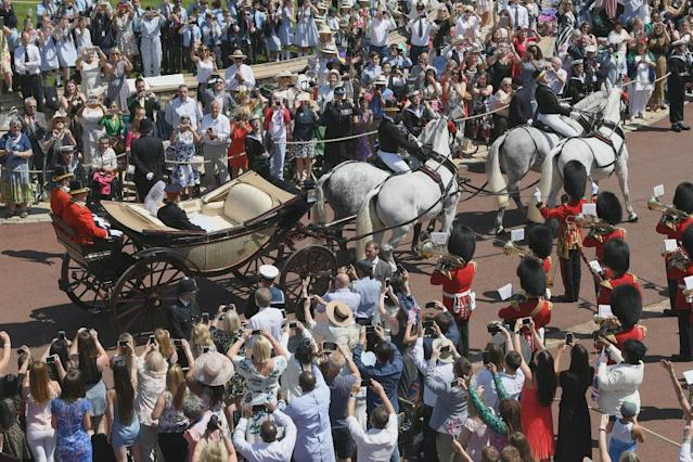 <p>A horse-drawn carriage lead the way for the royal couple as they left the church. (Photo: Getty) </p>
