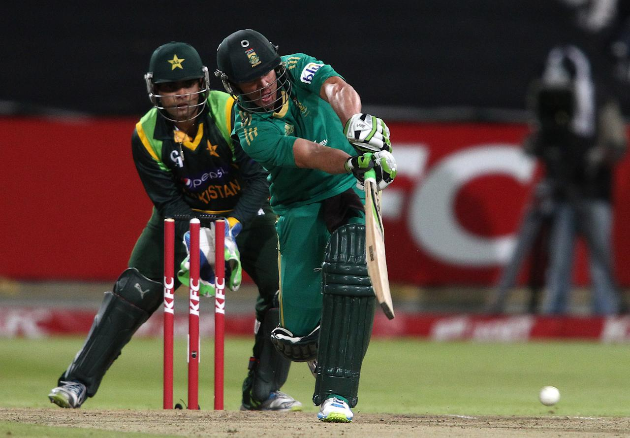 CAPE TOWN, SOUTH AFRICA - NOVEMBER 22: AB de Villiers of South Africa drives a delivery during the 2nd T20 International match between South Africa and Pakistan at Sahara Park Newlands on November 22, 2013 in Cape Town, South Africa. (Photo by Shaun Roy/Gallo Images/Getty Images)