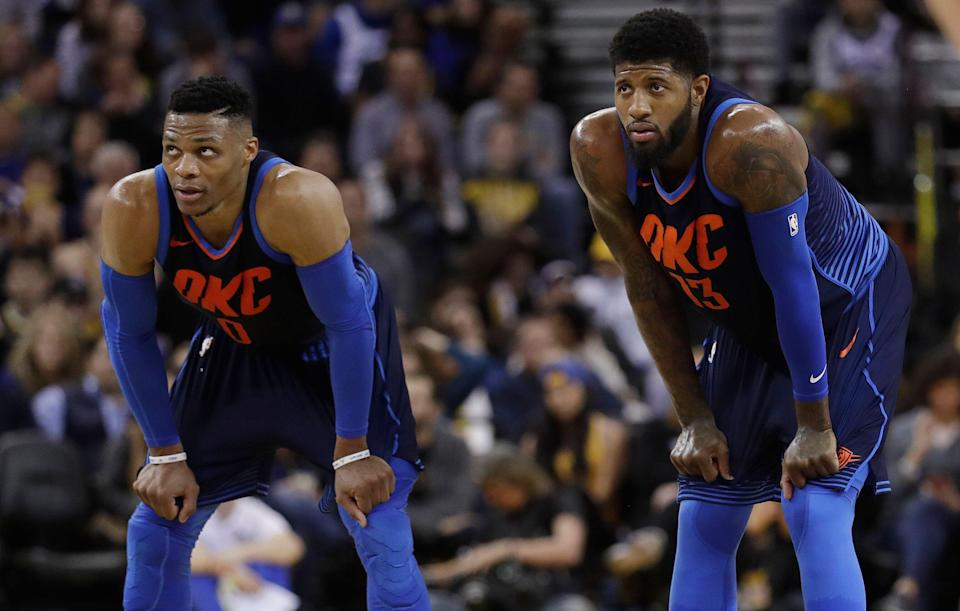 Oklahoma City Thunder's Paul George, right, and Russell Westbrook during the first half of an NBA basketball game against the Golden State Warriors Saturday, Feb. 24, 2018, in Oakland, Calif. (AP Photo/Marcio Jose Sanchez)