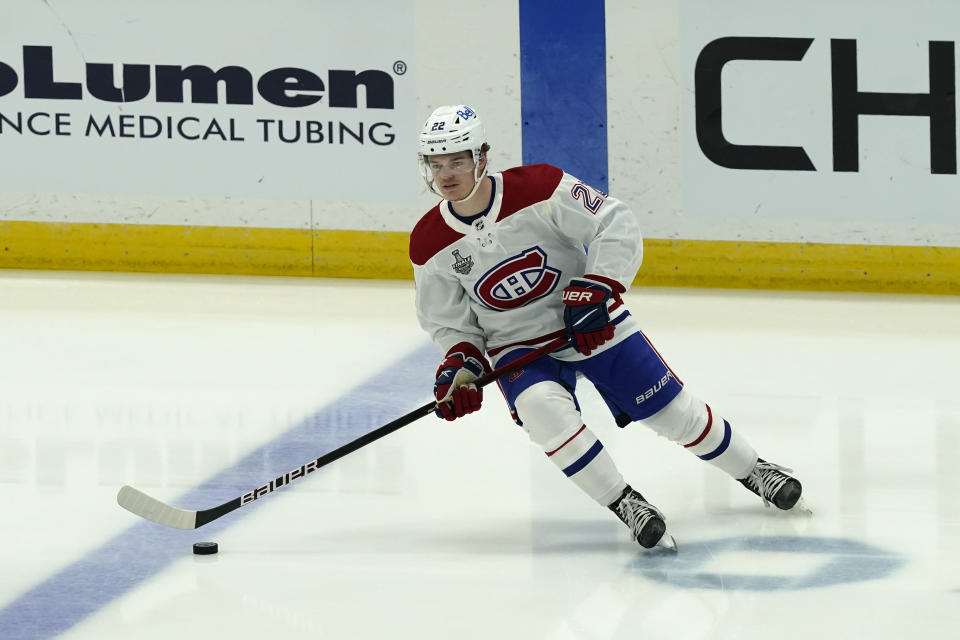 Montreal Canadiens right wing Cole Caufield warms up before the first period in Game 1 of the NHL hockey Stanley Cup finals, Monday, June 28, 2021, in Tampa, Fla. (AP Photo/Gerry Broome)