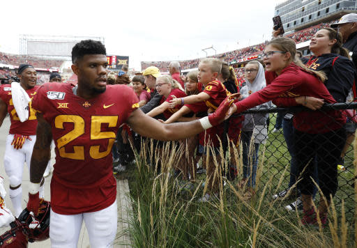 Iowa State running back Sheldon Croney, left, high-fives fans after their 29-26 win over Northern Iowa in triple overtime of an NCAA college football game, Saturday, Aug. 31, 2019, in Ames. (AP Photo/Matthew Putney)