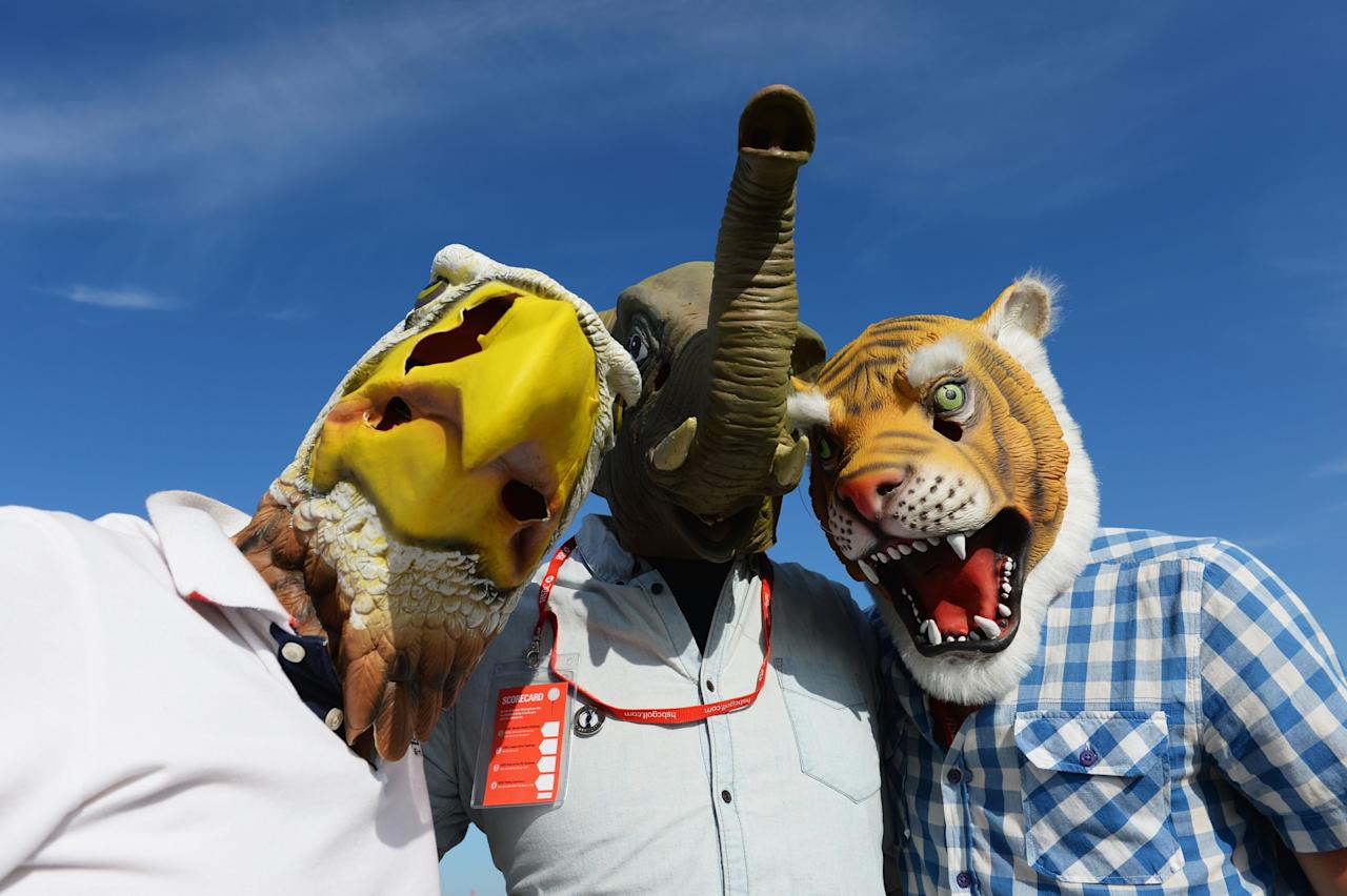 GULLANE, SCOTLAND - JULY 20: Golf fans wearing masks pose during the third round of the 142nd Open Championship at Muirfield on July 20, 2013 in Gullane, Scotland. (Photo by Stuart Franklin/Getty Images)