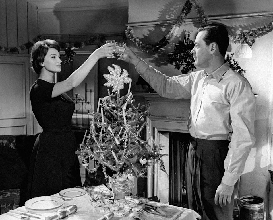 <p>The co-stars toast each other during a scene from their movie <em>The Key </em>in 1958.</p>