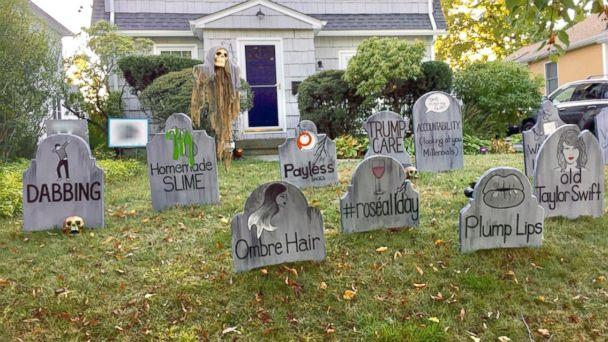 PHOTO: The art teacher's gravestones pay homage to normal seasons and watching live tv. (Michael Fry)