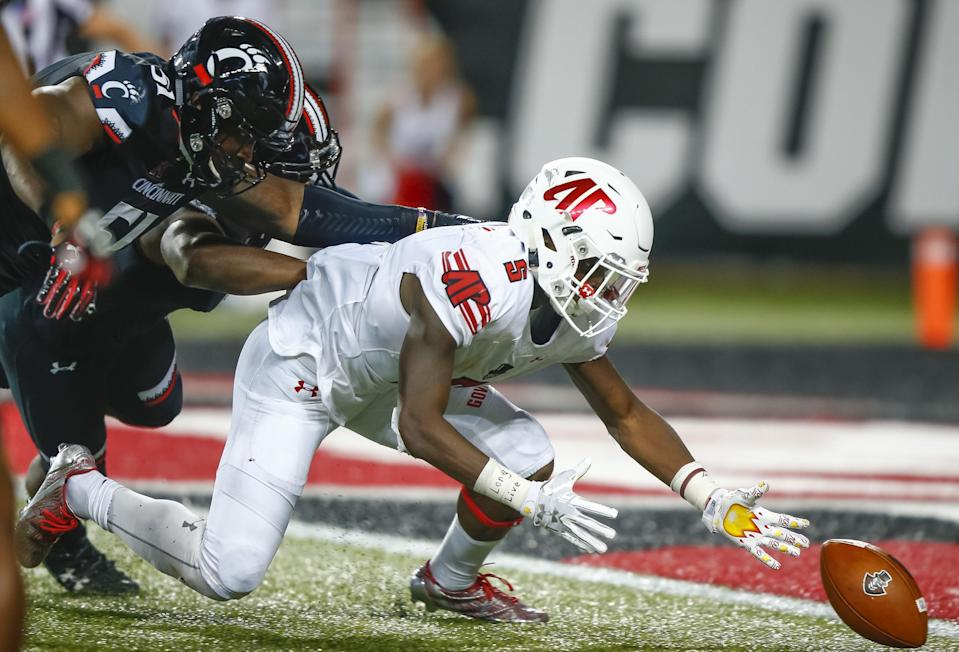 CINCINNATI, OH – AUGUST 31: Kentel Williams #5 of the Austin Peay Governors reaches for the fumbled ball as Kimoni Fitz #51 of the Cincinnati Bearcats defends at Nippert Stadium on August 31, 2017 in Cincinnati, Ohio. (Photo by Michael Hickey/Getty Images)