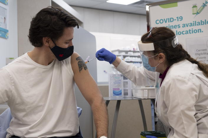 Prime Minister Justin Trudeau receives his first COVID-19 AstraZeneca vaccination in Ottawa on Friday April 23, 2021. (Adrian Wyld/The Canadian Press via AP)