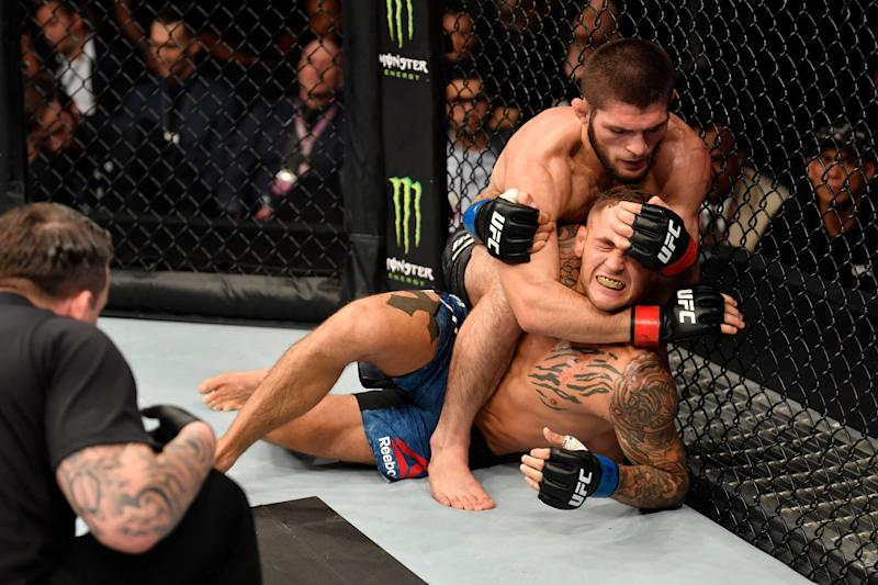 ABU DHABI, UNITED ARAB EMIRATES - SEPTEMBER 07: Khabib Nurmagomedov of Russia (top) attempts to submit Dustin Poirier in their lightweight championship bout during UFC 242 at The Arena on September 7, 2019 in Yas Island, Abu Dhabi, United Arab Emirates. (Photo by Jeff Bottari/Zuffa LLC/Zuffa LLC via Getty Images)