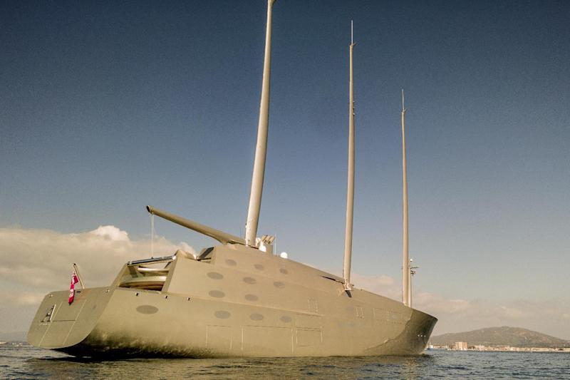 In this photo taken on Feb. 18, 2017, a large yacht floats in the bay of Gibraltar after being seized. Authorities in Gibraltar say they have seized one of the largest and most advanced superyachts in the world over an unsettled bill dispute between its owner and its German builder. The Gibraltar Chronicle newspaper reports that shipbuilder Nobiskrug claims 15.3 million euro ($16.2 million) in overdue payments for the 143-meter (468-foot) long Sailing Yacht A. (AP Photo/David Parody)