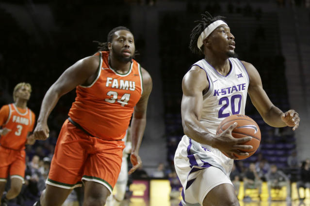 Kansas State's Xavier Sneed (20) gets past Florida A&M's Levi Stockard II (34) during the first half of an NCAA college basketball game Monday, Dec. 2, 2019, in Manhattan, Kan. (AP Photo/Charlie Riedel)