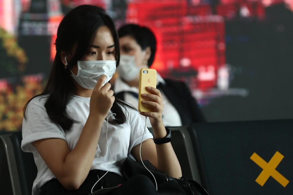 A woman wears a mask in Vnukovo International Airport, Moscow. (Getty Images)