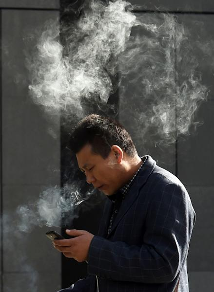 Among men, 52.9% smoke according to the latest available figures from the World Health Organization (WHO), among the highest rates in the world (AFP Photo/Greg Baker)