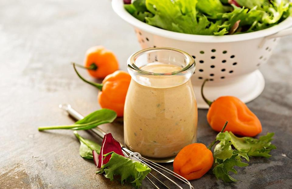 """<p>Spicy ranch dressing shouldn't be relegated to just salads. It will add a creamy kick to sandwiches as well, or you can use it as a dipping sauce for french fries, veggies and more.</p> <p><a href=""""https://www.thedailymeal.com/recipes/spicy-ranch-dressing-recipe-0?referrer=yahoo&category=beauty_food&include_utm=1&utm_medium=referral&utm_source=yahoo&utm_campaign=feed"""" rel=""""nofollow noopener"""" target=""""_blank"""" data-ylk=""""slk:For the Spicy Ranch Dressing recipe, click here."""" class=""""link rapid-noclick-resp"""">For the Spicy Ranch Dressing recipe, click here.</a></p>"""