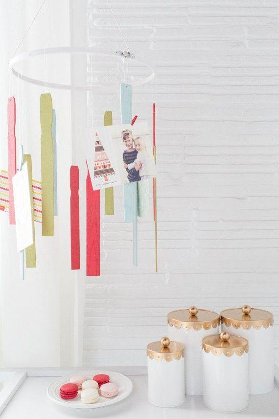 """<p>This hanging card mobile is oddly soothing to watch spinning around. </p><p>Get the tutorial at <a href=""""https://sugarandcloth.com/diy-holiday-card-mobile/"""" rel=""""nofollow noopener"""" target=""""_blank"""" data-ylk=""""slk:Sugar & Cloth"""" class=""""link rapid-noclick-resp"""">Sugar & Cloth</a>.</p>"""