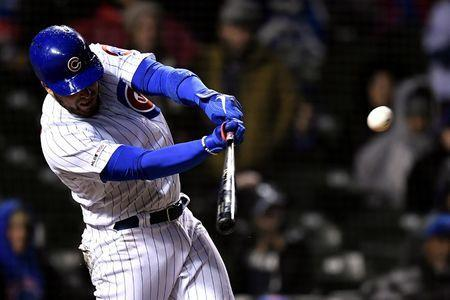 Apr 11, 2019; Chicago, IL, USA; Chicago Cubs catcher Victor Caratini (7) hits an RBI double in the seventh inning against the Pittsburgh Pirates at Wrigley Field. Mandatory Credit: Quinn Harris-USA TODAY Sports