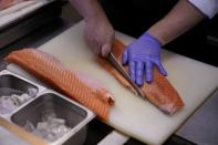 Chef and owner Austin Hu cooks a salmon at Heritage by Madison restaurant, in Shanghai