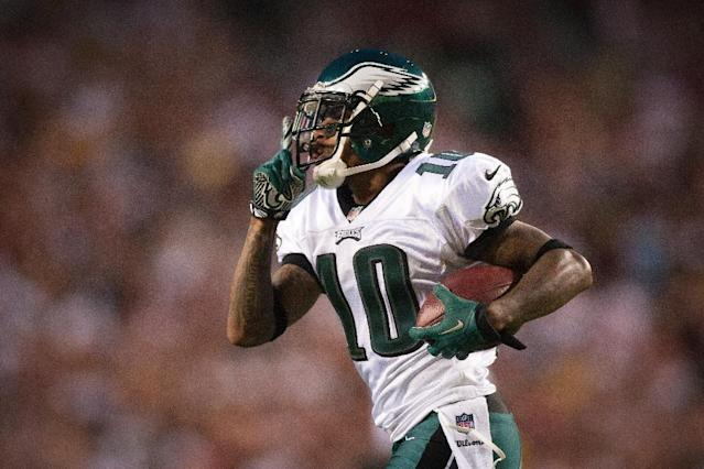 Philadelphia Eagles's DeSean Jackson signals to the Washington Redskins crowd after getting a touchdown in the first half of thier NFL football game, Monday, Sept. 9, 2013, in Landover, Md. (AP Photo/The Wilmington News-Journal, Suchat Pederson)