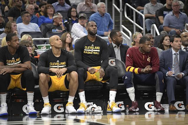 LeBron James takes a seat, and the world takes notice.(AP)