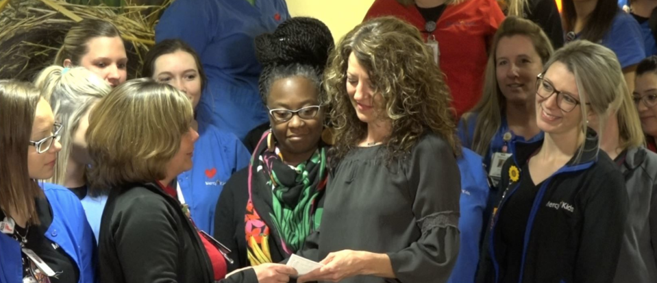 Nurses at Mercy Children's Hospital in St. Louis pooled their Mega Millions winnings and gave it to two deserving co-workers. (Photo: KMOV)