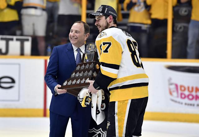 <p>Pittsburgh Penguins center Sidney Crosby (87) is presented with the Conn Smythe Trophy by NHL commissioner Gary Bettman after defeating the Nashville Predators in Game 6 of the 2017 Stanley Cup Final at Bridgestone Arena. Credit: Christopher Hanewinckel-USA TODAY Sports </p>