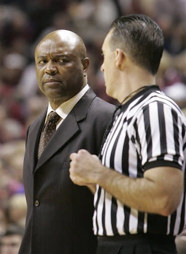 Florida State head coach Leonard Hamilton, left, listens to official Roger Ayers explain a call in the first half of an NCAA college basketball game against Miami on Saturday, Feb. 11, 2012 in Tallahassee, Fla.(AP Photo/Steve Cannon)