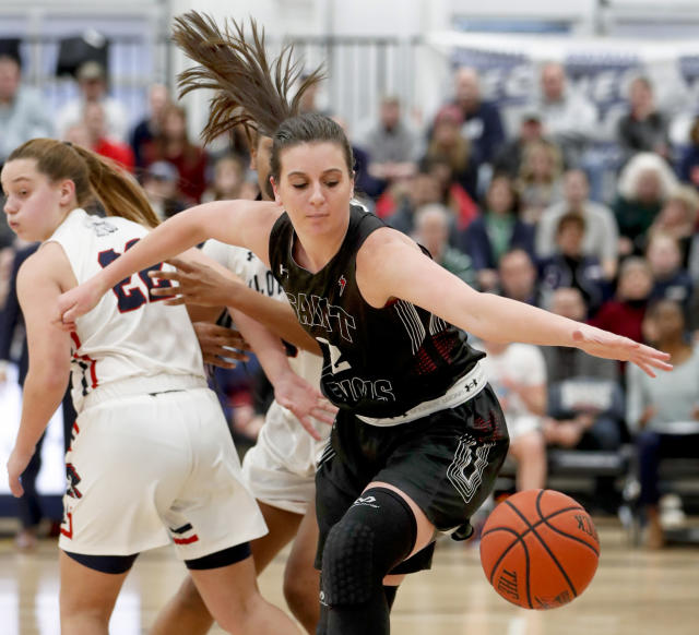 St. Francis (Pa)'s Courtney Zezza, right, chases the ball in front of Robert Morris' Esther Castedo (22) during the first half of an NCAA college basketball game for the championship of the Northeast Conference women's tournament, Sunday, March 17, 2019, in Moon, Pa. (AP Photo/Keith Srakocic)