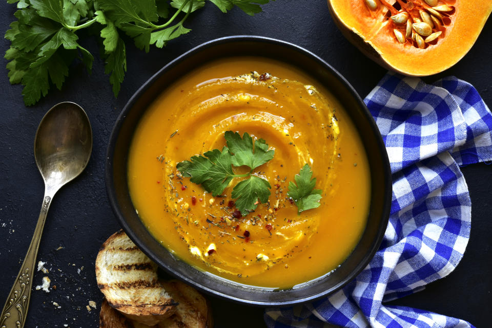 """<p>There's a reason butternut squash soup pops up in every fall recipe rundown. There's just something about the blend of warm spices and nutty flavour that makes it simply perfect for serving on a cold autumn day.</p> <p>If you're looking to give the classic recipe a little extra oomph, <a href=""""https://www.epicurious.com/recipes/food/views/winter-squash-soup-with-gruyere-croutons-2997"""" rel=""""nofollow noopener"""" target=""""_blank"""" data-ylk=""""slk:this winter squash soup from Epicurious"""" class=""""link rapid-noclick-resp"""">this winter squash soup from <em>Epicurious</em></a> elevates the seasonal standard by adding acorn squash to the mix and topping it all off with crispy croutons and broiled gruyère.</p> <p>Make sure you have a great immersion blender on hand if you plan on making lots of soups this fall. The <a href=""""https://www.canadiantire.ca/en/pdp/kitchenaid-variable-speed-corded-hand-blender-aqua-sky-0432389p.html?utm_source=vrz&utm_medium=display&utm_campaign=10009368_21_CTS_JNJ_FALL&utm_content=10009368_21_CTS_JNJ_FALL_EN_VRZ_CONS_TR_CAN_UTM_1x1_Kitchen%20Cookware"""" rel=""""nofollow noopener"""" target=""""_blank"""" data-ylk=""""slk:KitchenAid Variable Speed Corded Hand Blender"""" class=""""link rapid-noclick-resp"""">KitchenAid Variable Speed Corded Hand Blender</a> will give your soup a super silky texture.</p>"""