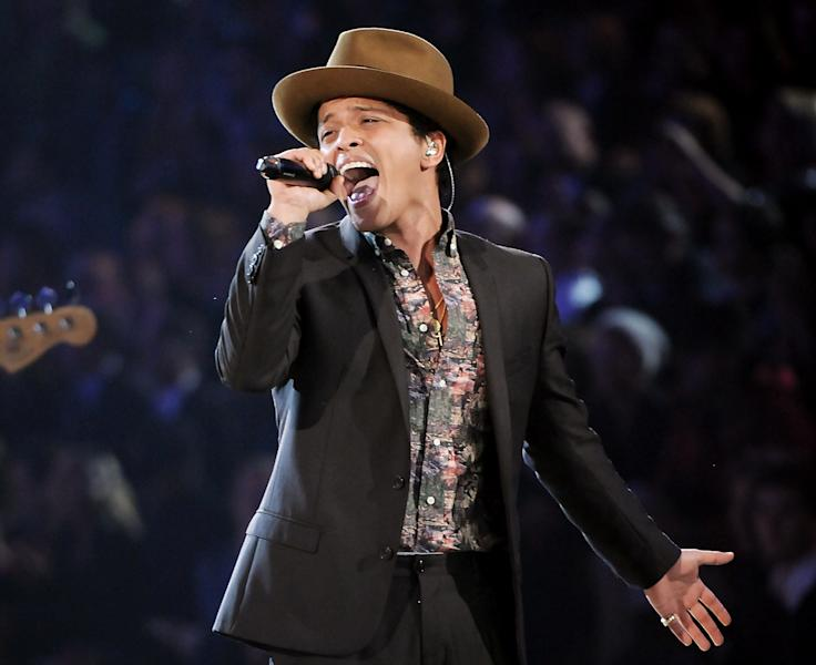 "FILE - This Nov. 7, 2012 file photo shows Bruno Mars performing during the 2012 Victoria's Secret Fashion Show in New York. Mars is releasing his sophomore album, ""Unorthodox Jukebox,"" featuring Grammy-winning jazz singer Esperanza Spalding and production and songwriting work by Mark Ronson, Jeff Bhasker, Diplo, Paul Epworth, Emile Haynie and the Smeezingtons, the production trio that includes Mars, Philip Lawrence and Ari Levine. (Photo by Evan Agostini/Invision/AP)"