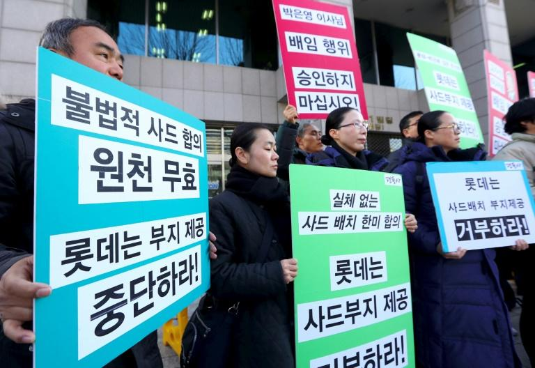South Korean activists demonstrate outside the Lotte headquarters in Seoul on February 27, in protest at the retailer providing land for the THAAD missile system