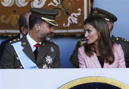Spain's Crown Prince Felipe and Spain's Princess Letizia attend a military parade marking Spain's National Day in Madrid