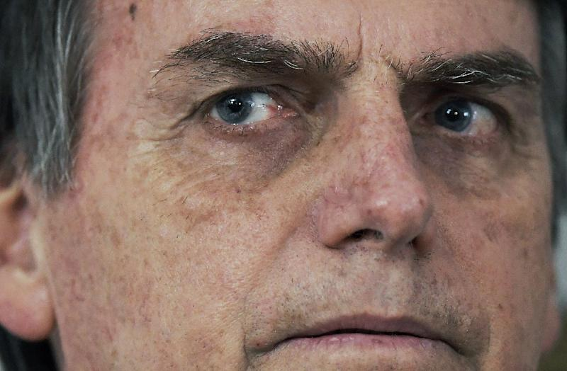 Bolsonaro himself was the victim of violence. On September 6 he was stabbed in the stomach by a mentally unbalanced lone assailant while campaigning (AFP Photo/CARL DE SOUZA)