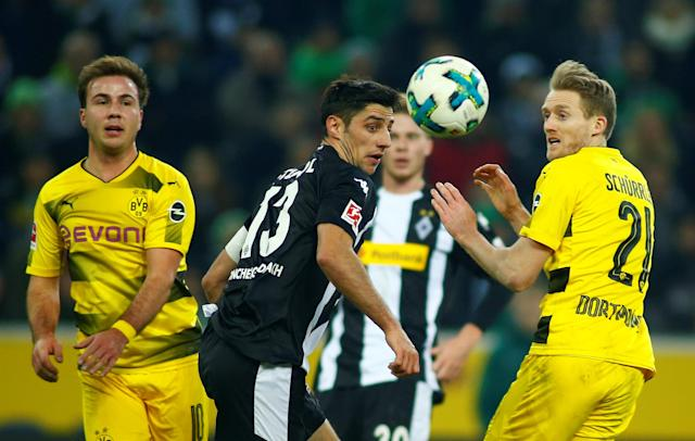 Soccer Football - Bundesliga - Borussia Moenchengladbach vs Borussia Dortmund - Borussia-Park, Moenchengladbach, Germany - February 18, 2018 Borussia Dortmund's Andre Schurrle and Mario Gotze in action with Borussia Moenchengladbach's Lars Stindl REUTERS/Thilo Schmuelgen DFL RULES TO LIMIT THE ONLINE USAGE DURING MATCH TIME TO 15 PICTURES PER GAME. IMAGE SEQUENCES TO SIMULATE VIDEO IS NOT ALLOWED AT ANY TIME. FOR FURTHER QUERIES PLEASE CONTACT DFL DIRECTLY AT + 49 69 650050