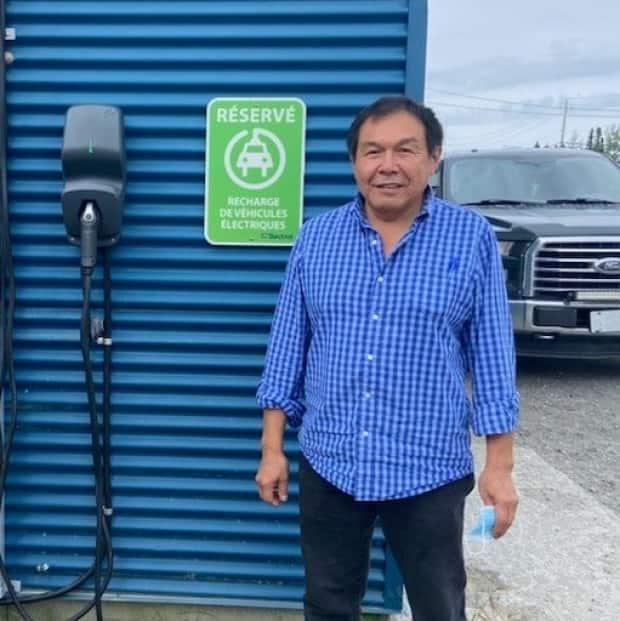 Raymond Menarick (right), co-owner of the École de Conduite Taauchiiwaatin - Driving School, says he hopes to offer driving lessons in an electric vehicle in several Cree communities. The company installed a first electric car charger in August in Chisasibi. (Louis-Rene Kanatewat - image credit)