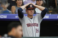 FILE - In this July 2, 2019, file photo, Houston Astros manager AJ Hinch reacts during a baseball game against the Colorado Rockies, in Denver. Houston manager AJ Hinch and general manager Jeff Luhnow were suspended for the entire season Monday, Jan. 13, 2020, and the team was fined $5 million for sign-stealing by the team in 2017 and 2018 season. Commissioner Rob Manfred announced the discipline and strongly hinted that current Boston manager Alex Cora the Astros bench coach in 2017 will face punishment later. Manfred said Cora developed the sign-stealing system used by the Astros. (AP Photo/David Zalubowski, File)