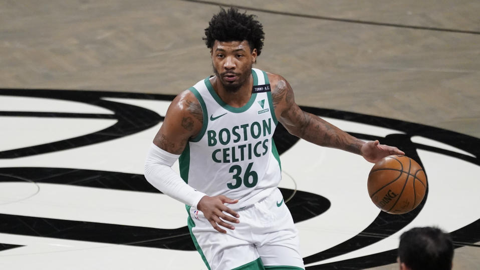 Boston Celtics guard Marcus Smart handles the ball during the first half of an NBA basketball game against the Brooklyn Nets, Friday, April 23, 2021, in New York. (AP Photo/Mary Altaffer)